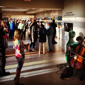 """A big crowd turned out for the Opening Reception of the """"Beyond the Stampede"""" art show on April 14, 2016."""