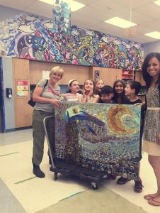 Hv Arts Council Program Director Carol Lipson, Bear Tavern Elementary Art Teacher Joslyn Johnson with Starry Night upcycled art piece created by Bear Tavern students