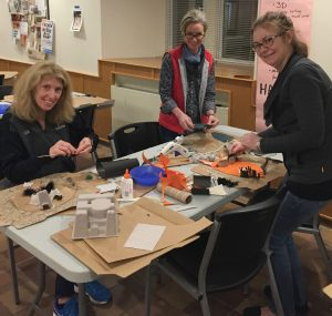 Hopewell Valley Arts Council volunteers make upcycled decorations for Salon Redux